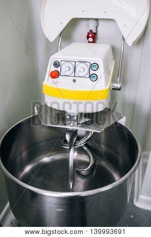Closeup of dough mixer in a bakery