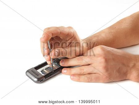 Male Hands Apart The Phone For Repair