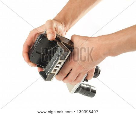 Male Hands Taking Out A Tape From An Old Camcorder