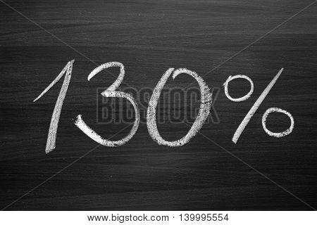 130 percent header written with a chalk on the blackboard