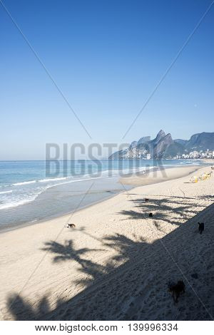 Ipanema Beach, Rio De Janeiro, Brazil - Scenic View With Two Brothers Mountain And Shadow Of Palm Tr