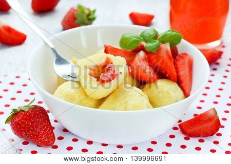Dumplings of cottage cheese with strawberries dietary tasty dish for dessert or breakfast selective focus
