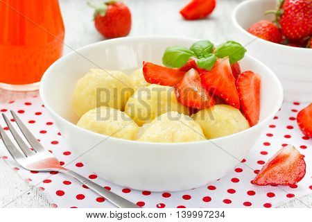 Lazy cheese dumplings with fresh strawberry selective focus
