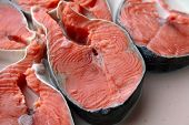 Fresh red salmon in milk before preparation poster