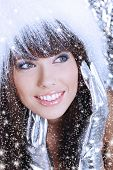 Winter Girl with beautiful make up, silver gloves and snow flake, silver background poster