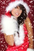 Portrait of beautiful sexy girl wearing santa claus clothes on red background poster