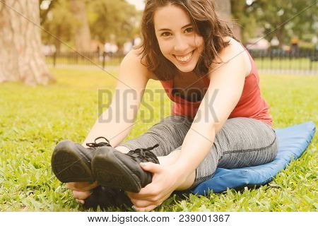 Portrait Of Sport Woman Streching Legs. Outdoors