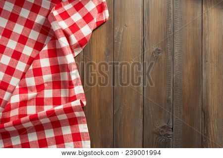 checkered napkin cloth on wooden background