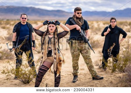 In A Post-apocalyptic Desert Wasteland, A Queen Of The Apocalypse Leads Her Militia Against The Enem