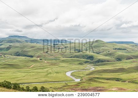 A Farm Landscape With The Mlambonja River Near Cathedral Peak In The Kwazulu-natal Drakensberg
