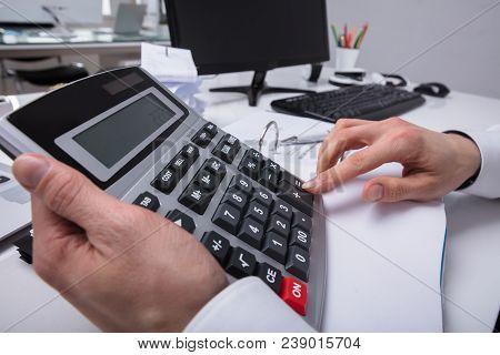 Businessperson Using Calculator