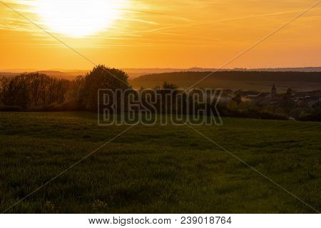 French Landscape - Lorraine. A Small Village In Lorraine Surrounded By Fields At Sunset.