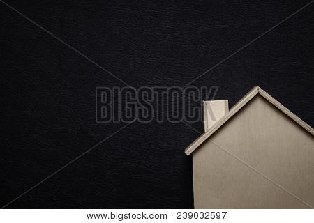 Wooden Home With Black Background. Home Sweet Home Concept. Idea And Creative Theme. Texture And Con