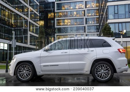 Warsaw, Poland-april 2018: New Suv Jeep Grand Cherokee Model Against The Background Of Modern Buildi
