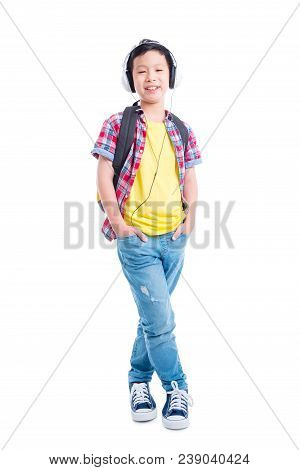 Full Length Of Young Asian Schoolboy Standing And Smiling Over White Background