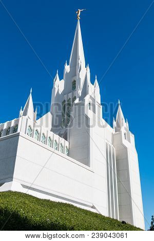 LA JOLLA, CALIFORNIA/USA - FEBRUARY 24, 2018:  The eastern spire of the San Diego LDS (Mormon) temple by design architect William Lewis, with a gold statue of the angel Moroni blowing a horn on top.