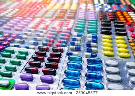 Colorful Of Tablets And Capsules Pill In Blister Packaging Arranged With Beautiful Pattern With Flar
