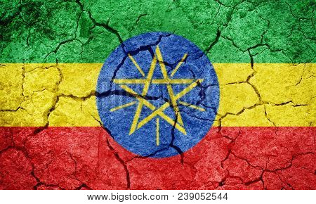 Federal Democratic Republic Of Ethiopia Flag On Dry Earth Ground Texture Background