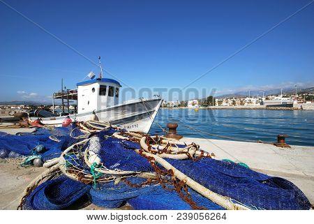 Caleta De Velez, Spain - October 27, 2008 - Traditional Fishing Boat In The Harbour With Fishing Net