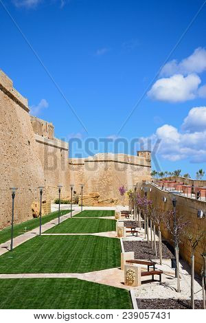 Victoria, Gozo, Malta - April 3, 2017 - Fortified Buildings And Landscaped Gardens Of The Old Moat W