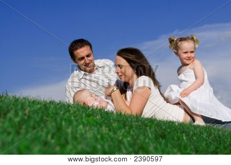 Happy Family Relaxing Outdoors