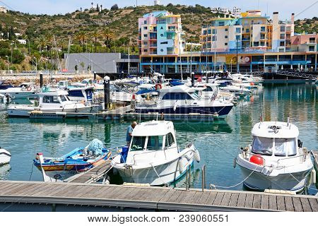 Albufeira, Portugal - June 8, 2017 - Boats Moored In The Marina With Apartments And Waterfront Busin