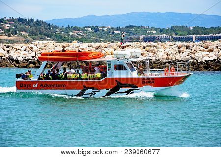 Lagos, Portugal - June 9, 2017 - Tourists Aboard A Dolphin Sightseeing Tour Boat Along The River Ben
