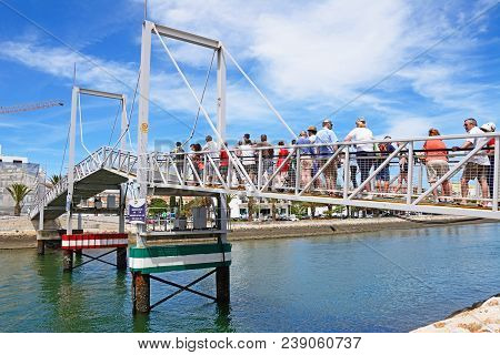 Lagos, Portugal - June 9, 2017 - Pedestrians Waiting For The Footbridge Along The River Bensafrim To