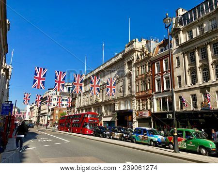 LONDON - MAY 3, 2018: Union Jack flags hanging across Piccadilly in London, UK.