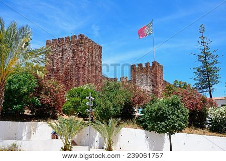 View Of The Medieval Castle With A Portuguese Flag Atop, Silves, Portugal, Europe.