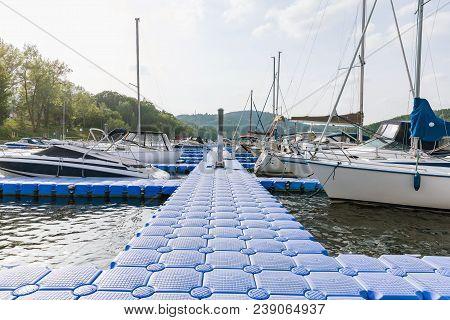 Plastic Pontoon Floating In The Lake Plastic Floating Dock,.plastic Pontoon Pier Leading To To Ancho