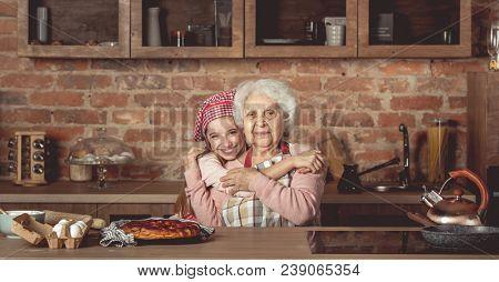 Granddaughter hug her happy grandmother