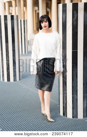 Woman With Red Lips Makeup In Paris, France. Sensual Woman With Brunette Hair. Beauty Girl With Glam