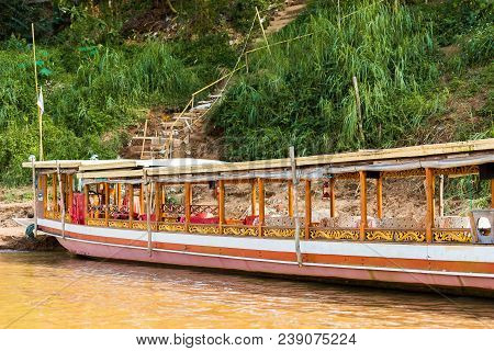 Boat Near The Bank Of The River Nam Khan In Luang Prabang, Laos. Copy Space For Text.