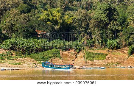 View Of The Landscape Of The River Nam Khan, Luang Prabang, Laos. Copy Space For Text