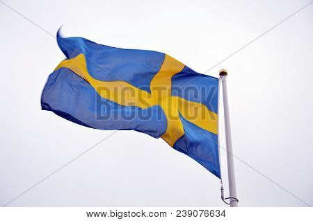 The Waving National Flag Of Sweden In White Background