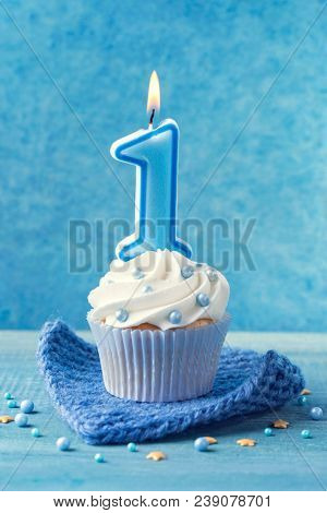 Cupcake with a blue candle for first birthday
