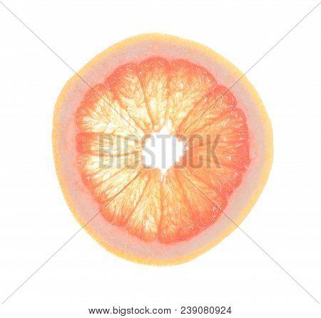 Juicy Slice Of Grapefruit  Isolated On White