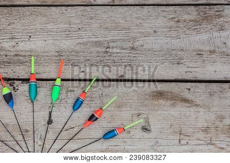Fishing Floats On A Wooden Background. Floats The Fishing Different On Office Table, Cope Space.