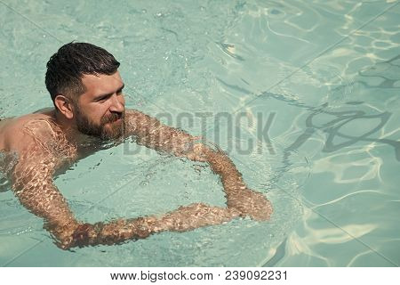 Bearded Man Swimming In Blue Water. Summer Vacation And Travel To Ocean. Relax In Spa Swimming Pool,