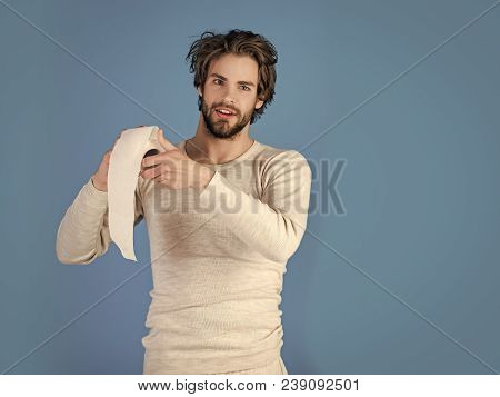 Sterility and purity. Man with happy face hold toilet paper, single. Hygiene and sanitary. Man in underwear with disheveled hair, morning. WC and restroom. diarrhea poster