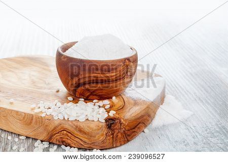 Gluten Free Rice Flour In A Wooden Bowl For Celiac Disease People.