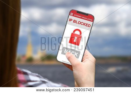 Ip Blocked Idea, Girl With Frameless Phone On Blurred Clouds Background