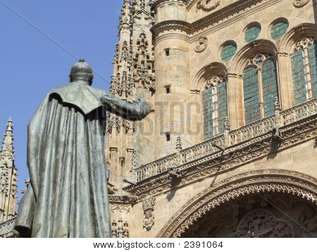 Statue And Cathedral Building In Salamanca, Spain