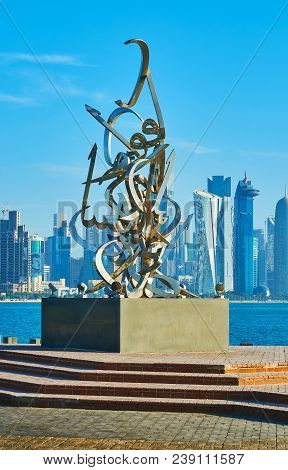 Doha, Qatar - February 13, 2018: The Corniche Promenade Is Decorated With Calligraphy Sculpture Of S
