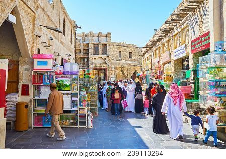 Doha, Qatar - February 13, 2018: The Pet Market, Of Souq Waqif With Crowd Of Locals, Looking For Int