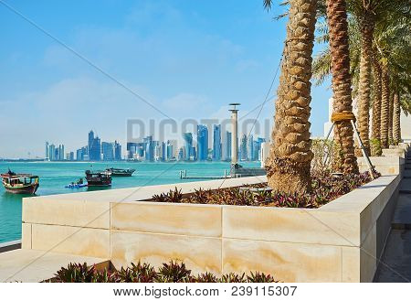 The Palm Alley Along The Way To Museum Island With A View On Coast Of Persian Gulf And Modern Archit