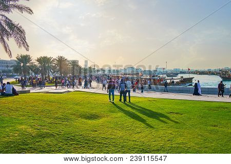 Doha, Qatar - February 13, 2018: The Sunset Over The Multi-crowded Corniche Promenade, This Place Is