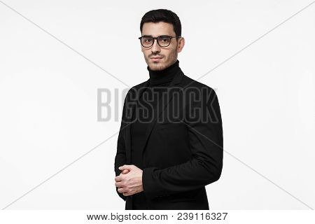 Half-length Portrait Of Young Handsome Caucasian Guy Isolated On White Background Dressed In Black T