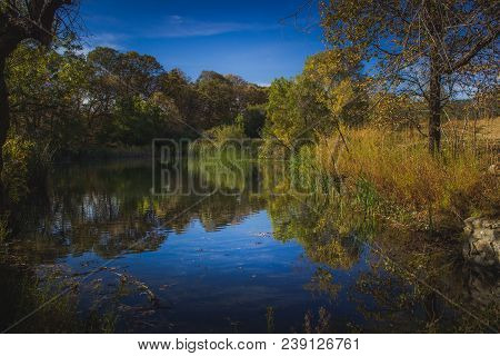 Stunning Fall Foliage Surrounding A Small Lake With Reflections Of Blue Sky And Trees, Oak Glen Pres